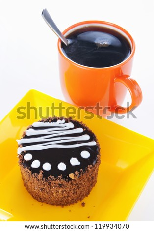 Round biscuit cake with cup of coffee