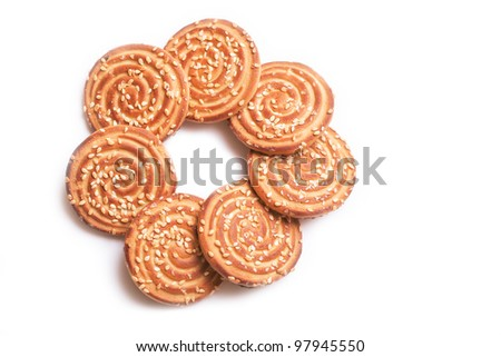 round biscuit sprinkled with sugar on a white background