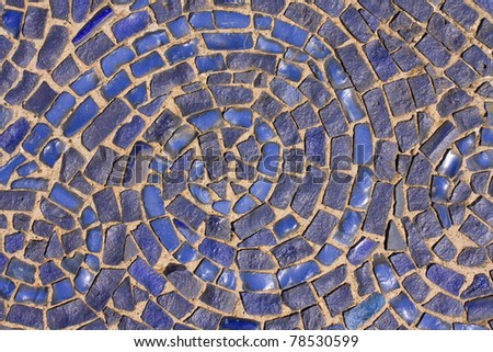 Round blue mosaic texture on the wall - stock photo