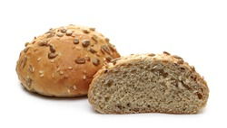 Round bread loafs, buns with mixed seeds and sliced half isolated on white background