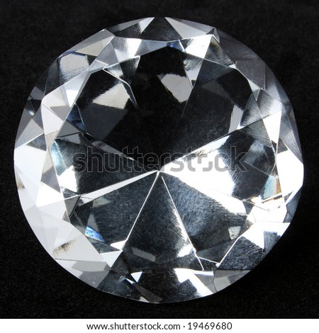 Round brilliant cut diamond isolated on black
