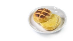 Round bun charcoal grilled serve with crispy bread skin, isolated on the white background, focus on well-done area.