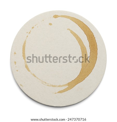 Round Cardboard Coaster With Drink Ring Stains Isolated on White Background.