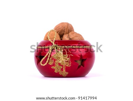 Round Christmas candle holder with walnuts isolated on white background