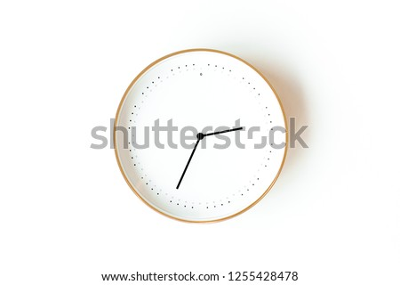 Round clock isolated on white background. Minimal concept. Flat lay. Top view.