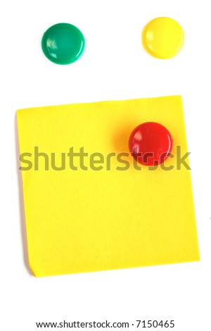 Round colored magnets with blank yellow post-it isolated on white
