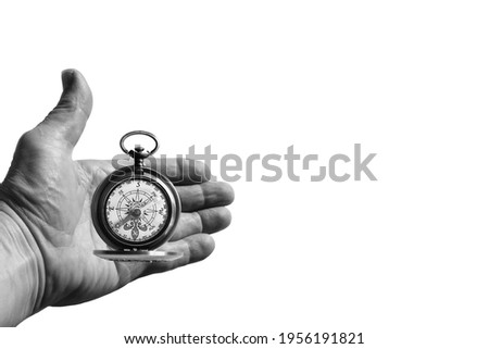 round compass in hand isolated on white background for abstract image with place for text as symbol of tourism with compass, travel with compass and outdoor activities with compass