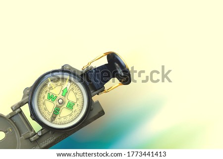 round compass on abstract background as symbol of tourism with compass, travel with compass and outdoor activities with compass