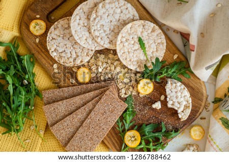 Round crispy rice crackers and Rye Crackers whith kumquat. Dietary concept and healthy vegetarian food #1286788462