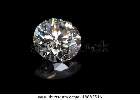 Round Diamond on Black Background with Reflection
