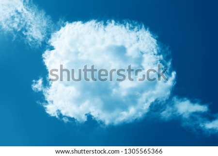 Round fluffy cloud in clear blue sky. Peaceful cloudy sky natural background, frame. Sunny day, light. Divine shining heavenly background, heaven #1305565366