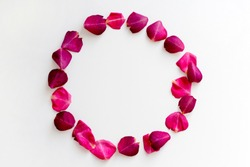 Round frame from pink rose petals on white background. Romance concept. Top view, flat lay, copy space
