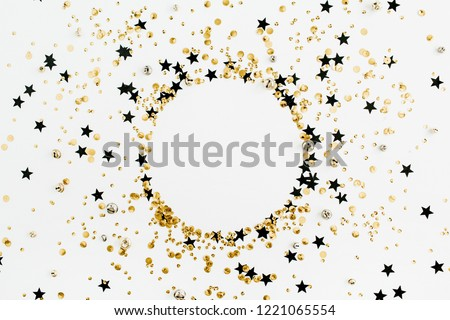 Round frame of festive holiday background with sparkle glitter decoration. Flat lay, top view Christmas or New Year pattern. Mock up. #1221065554