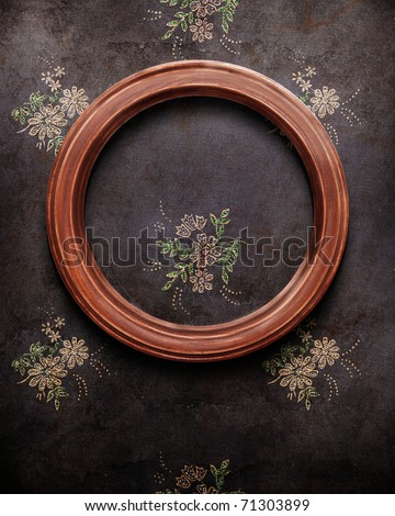 round frame on black shabby wallpaper