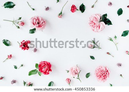 Photo of round frame wreath pattern with roses, pink flower buds, branches and leaves isolated on white background. flat lay, top view
