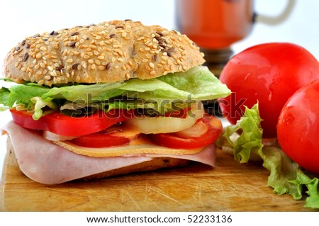 stock-photo-round-fresh-sandwiches-with-ham-cheese-and-tea-tomatos-in-background-52233136.jpg