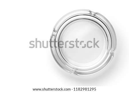 Round glass ashtray isolated on white background. Top view.