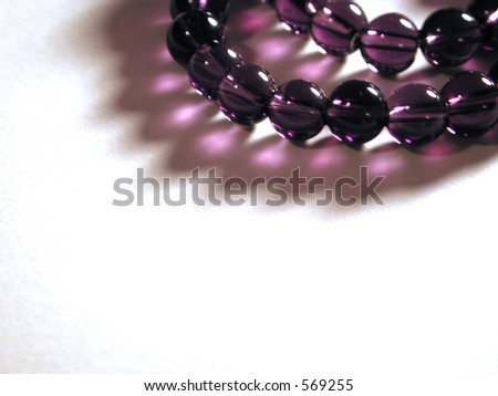 Round glass violet beads.