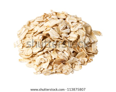 round heap of oat flakes isolated on white background