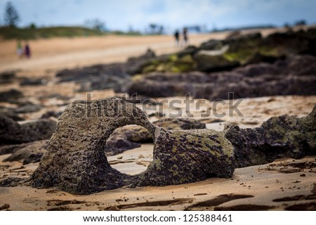 Round hole in a beach stone