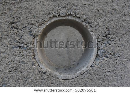 round hole in cement as pipeline