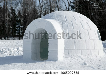 Round Igloo icehouse , Snowhouse yurt, Eskimo shelter built of ice