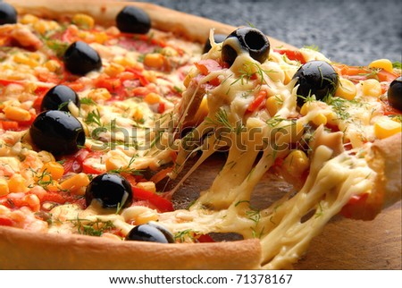 Round Italian pizza with salami, olives, capsicum and cheese