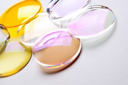 Round lenses for glasses with anti-reflective coating on a white background. Production of glasses and spectacle lenses.