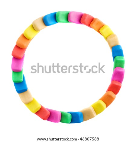 Round made of colorful plasticine bricks with copyspace