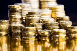 round metal coins of Golden color, legal tender that is used for payments in the state, beautiful coins closeup, different coin denominations