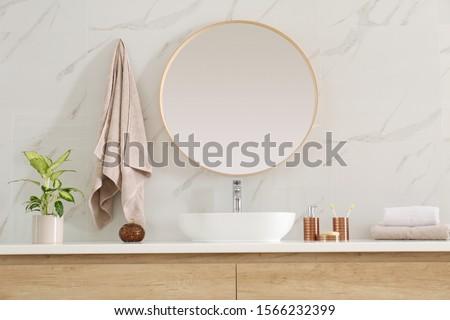 Round mirror over vessel sink in stylish bathroom interior Photo stock ©