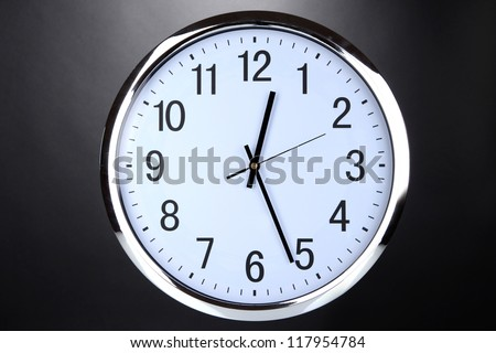round office clock on black background
