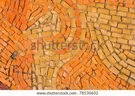 Round orange mosaic texture on the wall