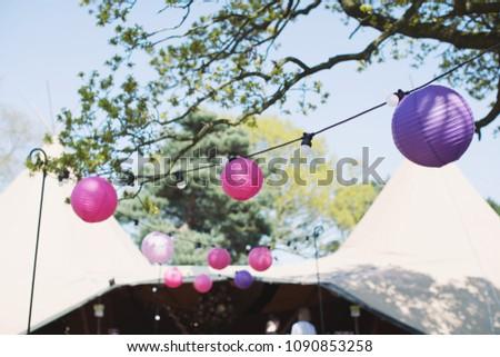 round paper lanterns hung up at ...