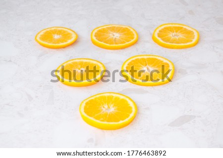 Round pieces of juicy orange on the table, top view