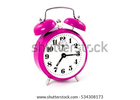 Round pink alarm clock on white background isolated. The image of the retro clock shows a quarter past seven - concept timer standard time change alert retro clock design start end hour signal.