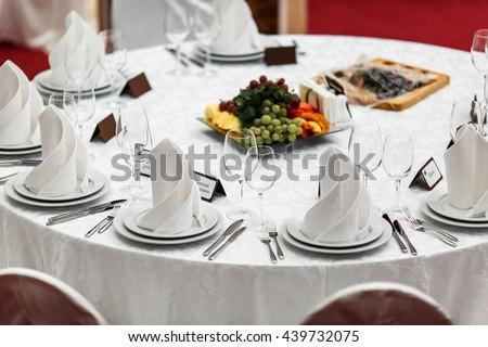 Round restaurant table served luxury for a festive dinner