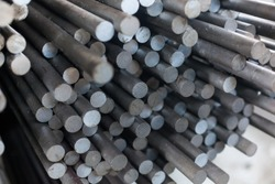 Round rolled steel stored in the warehouse. Designed for wholesale, retail sale or for the manufacture of parts at the plant or fittings for the construction