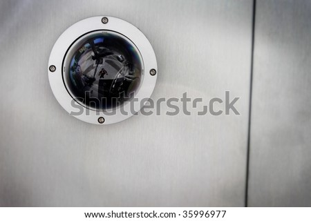 Round Security Camera In A Silver Metal Ceiling Stock