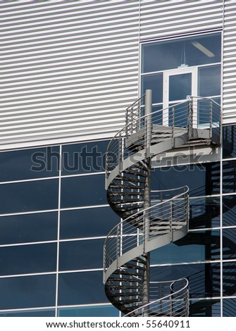 round set of stairs leading down from a mysterious glass door
