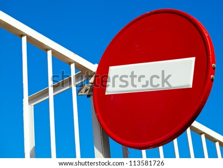 Round sign No Entry on blue sky background