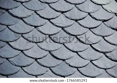 Round slate shingles,beautiful detailed slate roof.The slates rounded by hand