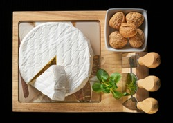 Round soft cheese, with a section cut