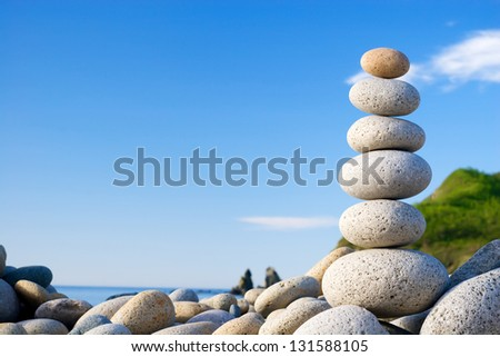 Round stones for meditation laying on seacoast