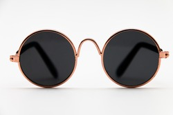 Round sunglasses close-up on a white background
