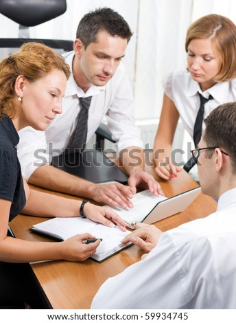 Round table of many business people. Office workers communicating and discussing problems and issues existing in their company or firm in board room Hi Res.