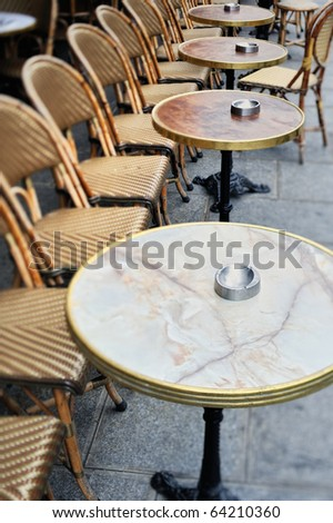 Round tables and chairs in cafe in Paris. Photo with tilt-shift effect