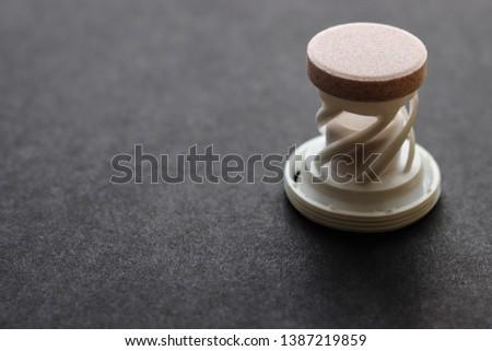 Round tabletka on a white stand on a black background Zdjęcia stock ©