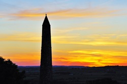 round tower and sunset at Ardmore, Co.Waterford, Ireland