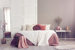 Round velvet pillow on king size bed with cozy bedding